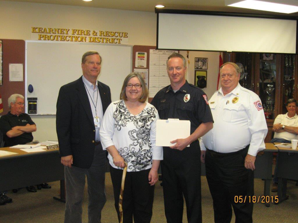 Jay McClintick from St. Lukes presenting award, Linda Smith, FF-EMT-P Barnhart, Chief Pratt, not pictured FF-EMT Pierce, 05-18-15